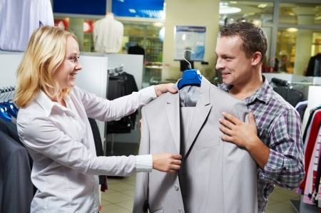 Young couple at clothes shopping Stock Photo - 10635346