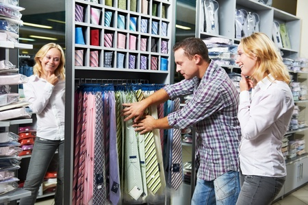 clothing shop: Young couple at clothes shopping