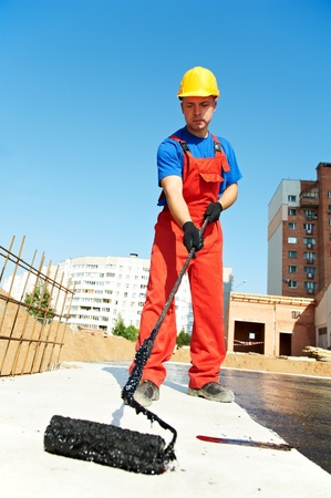 builder worker at roof insulation work Stock Photo - 10668901
