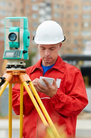 measuring instruments: surveyor works with theodolite Stock Photo