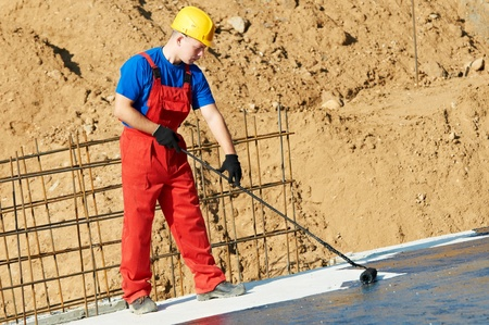 builder worker at roof insulation work photo