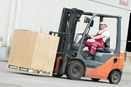 warehouse worker driver in forklift Stock Photo - 10698146