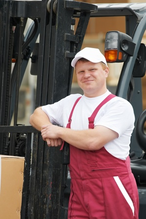 warehouse worker in front of forklift Stock Photo - 10698143