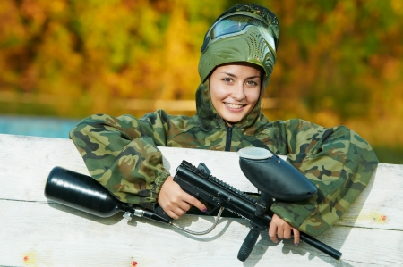 camouflage woman: girl paintball player Stock Photo