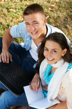 Two smiling young students outdoors photo