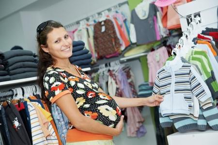 Young pregnant woman at shop photo