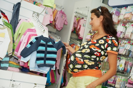 Young pregnant woman at shop photo