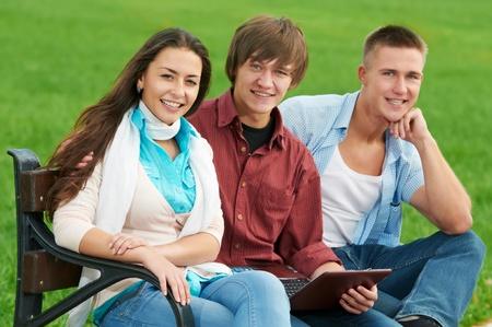 Group of smiling young students outdoors Stock Photo - 10697910
