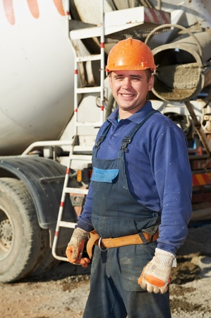 taskmaster: builder worker at construction site Stock Photo