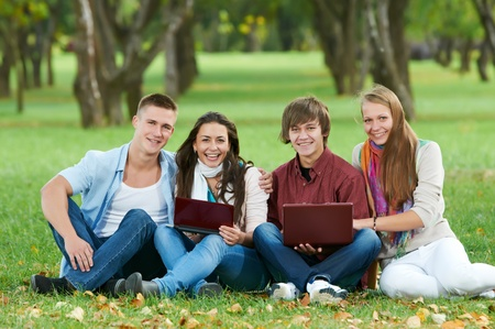 Group of smiling young students outdoors Stock Photo - 10697877