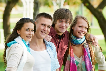 Group of smiling young students outdoors Stock Photo - 10697907
