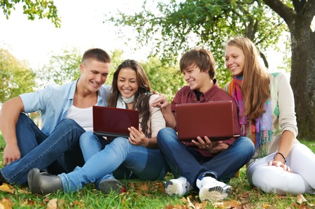 Group of smiling young students outdoors photo