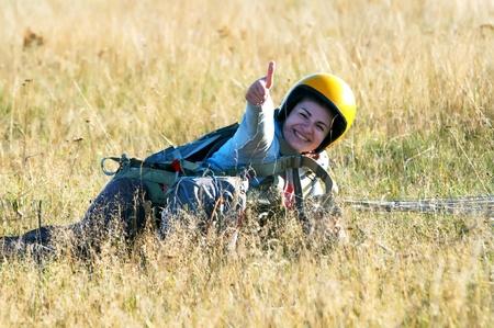 parasailing: Parachute jumper after landing Stock Photo