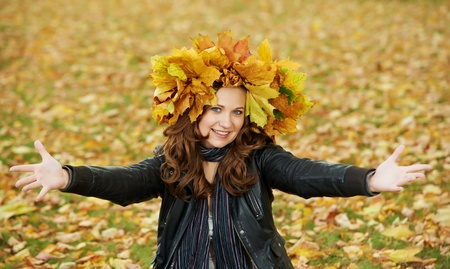 Woman with maple wreath at autumn outdoors Stock Photo - 10815970