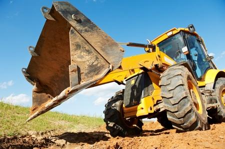 Excavadoras Cargadoras con obras retroexcavadora Foto de archivo