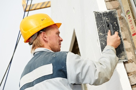 leveling: builder facade plasterer worker Stock Photo