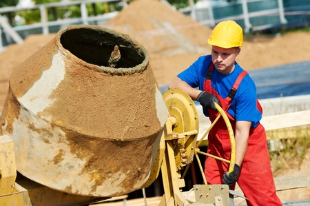 cement solution: builder worker at construction site Stock Photo
