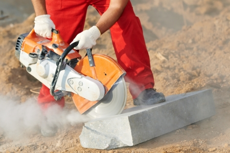 power tools: builder at cutting curb work