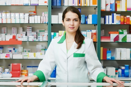 Pharmacy chemist woman in drugstore photo