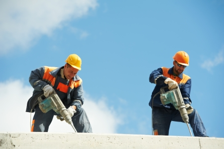construction workers with perforator photo