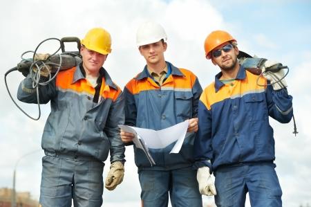 Pre�lufthammer: Bauarbeiter mit Elektrowerkzeugen Lizenzfreie Bilder