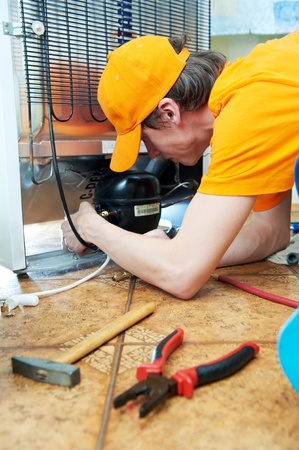 home repair: repair work on fridge appliance