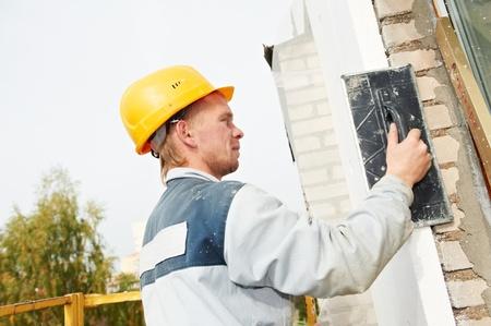 plasterer: builder facade plasterer worker Stock Photo