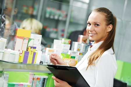 medical clipboard: Pharmacy chemist woman in drugstore Stock Photo