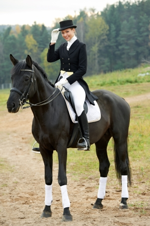 horsewoman jockey in uniform with horse Stock Photo - 11006456