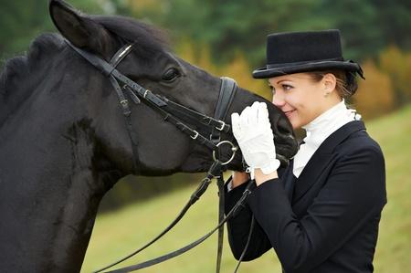 autumn horse: horsewoman jockey in uniform with horse Stock Photo