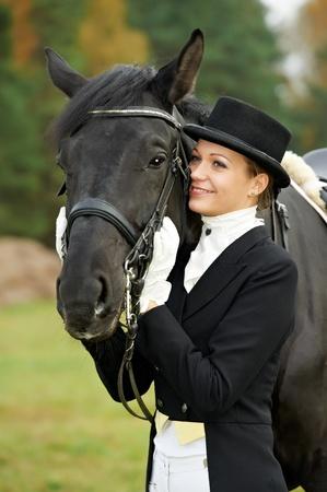 horsewoman jockey in uniform with horse Stock Photo - 11006395