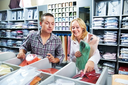 Young couple people at clothes shopping Stock Photo - 11006437