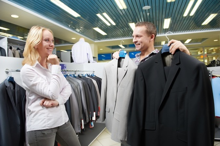 Young couple at clothes shopping photo