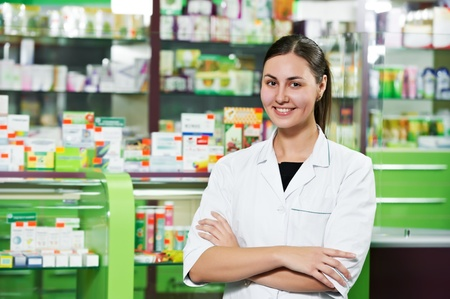seller: Pharmacy chemist woman in drugstore Stock Photo