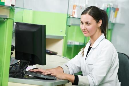 doctor computer: Pharmacy chemist woman in drugstore Stock Photo