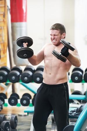bodybuilder lifting weight at sport gym photo