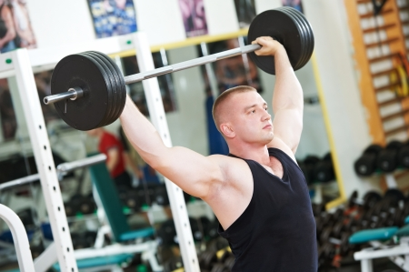 bodybuilder lifting weight at sport gym photo