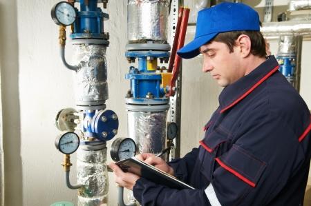 heating engineer repairman in boiler room Stock fotó