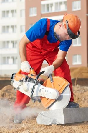 kerb: builder at cutting curb work