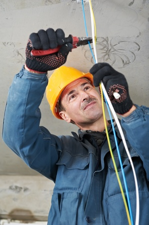 electrician tools: Electrician at wiring work