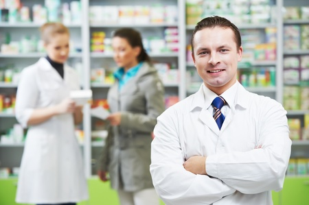 pharmacist: Confident pharmacy chemist man in drugstore