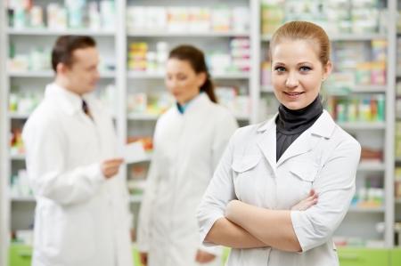 pharmaceutical drug: Pharmacy chemist woman in drugstore Stock Photo