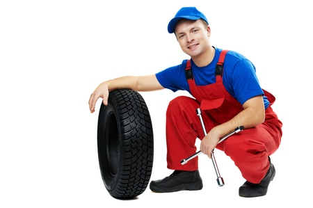 maintenance fitter: automobile mechanic with car tire and spanner