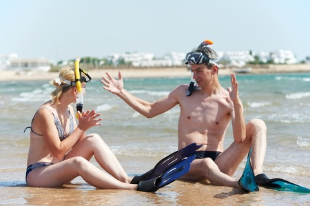 couple at sea beach with snorkel set photo