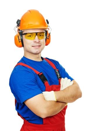 obrero: constructor en casco, orejeras y gafas
