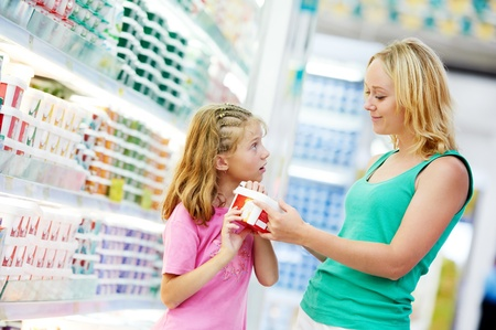 produce departments: woman and girl making shopping Stock Photo