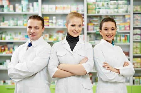pharmacist: Pharmacy chemist team women and man in drugstore Stock Photo