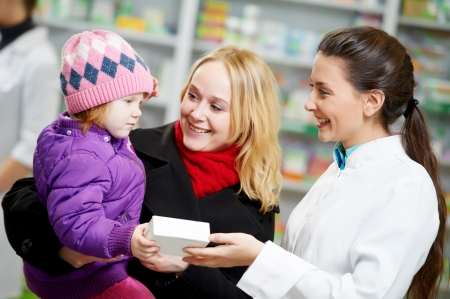 Pharmacy chemist, mother and child in drugstore photo