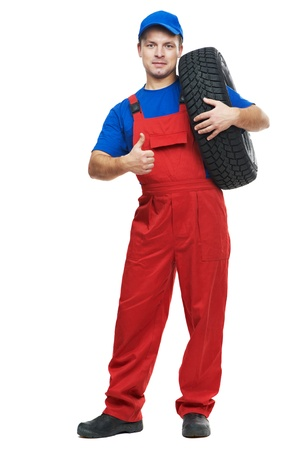 tire fitting: repairman automobile mechanic with car tire