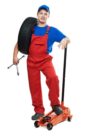 tire fitting: automobile repairman with tire and lifting jack
